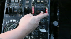 Aircraft panel hand flicks switch 13 Stock Footage
