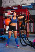gym woman with weighted ball and rope - stock photo