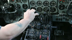 Hand operating engine controls in aircraft 03 Stock Footage