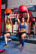 gym women weighted ball workout exercise - stock photo