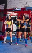 Gym women with barbell and kettlebell workout Stock Photos