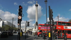 Admiral Nelson watches over pedestrians and traffic at Trafalgar square Stock Footage
