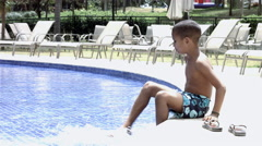 Funny Mixed Race Black and Latino Brazilian Sitting on board in the Pool Stock Footage