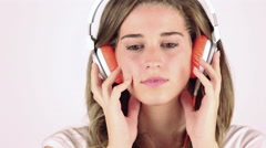 Sad Young Woman Listening Music with Headphones Stock Footage