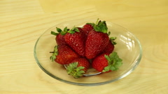 Fresh strawberries in a glass plate Stock Footage