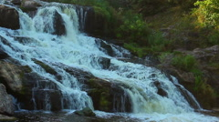 Magnificent cascade waterfall in the woods. Beautiful landscape Stock Footage