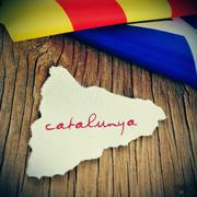 Catalunya, catalonia written in catalan in a piece of paper in the shape of c Stock Photos