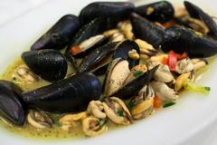 Appetizing dish with mussels - stock photo