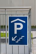 traffic sign: access to underground parking - stock photo