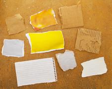 assorted pieces of ripped paper on grunge background - stock photo