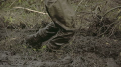 a man in boots walking onto the thick mud fs700 4k - stock footage
