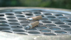 close up view of the cigarette butt on the bin fs700 4k - stock footage