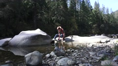 Gold miner, panning Yuba River Stock Footage