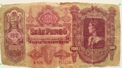 Paper money 100 Pengo Magyar Budapest in 1930 on a white table flipped a hand Stock Footage
