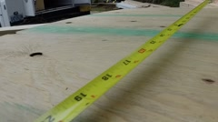 Measuring tape retracted - stock footage