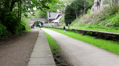 Family cyclists and walkers on the Monsal Trail Derbyshire Stock Footage