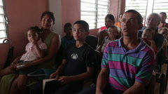 People Sing Hymns in Home Church in Cuba - stock footage