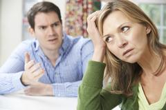 Couple having arguement at home Stock Photos