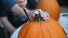 Cutting lid from pumpkin - stock footage