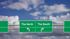 Divided two lane road sign. To The North or The South. The north south divide. - stock footage
