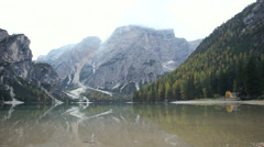 Lake of Braies Italy in middle of dolomiti italian alps mountain Stock Footage