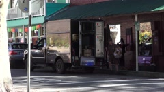 Historic gold mining town, UPS loading trucks Stock Footage