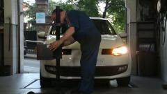 Car Repair Mechanic Adjusting Headlights Stock Footage