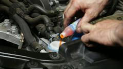Car Repair Mechanic Filling the Washer Fluid Tank Stock Footage