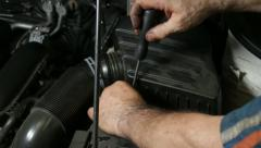 Car Repair Mechanic Screwing Automobile Air Filter Stock Footage