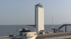 Vlietermonument, a watchtower at the Dutch Afsluitdijk (enclosure dam) Stock Footage
