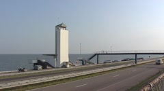 Watchtower vlietermonument Dutch Afsluitdijk, lake IJsselmeer in background. Stock Footage