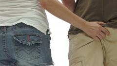 Woman Squeezing Man Bum Stock Footage