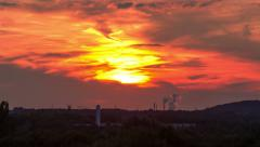 Fiery red sunset in industrial area Stock Footage