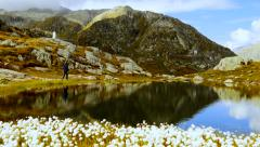 recreational activity of young male hiker walking in mountain landscape scenery - stock footage