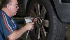 Car Repair Mechanic Mounts Wheel Stock Footage