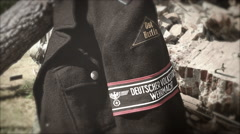 Volkssturm Ost Berlin Jacket and Armband w/ smoke and debris Stock Footage