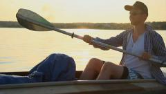 Young smiling man kayaking, enjoying active rest, vacation, click for HD Stock Footage