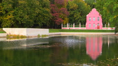 The Moscow park Kuskovo. Dutch house is reflected in the water of the pond. Stock Footage