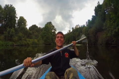 Young positive man paddling kayak, action camera, active rest, click for HD Stock Footage