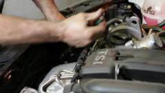 Car Repair Removing the Oil Filter Stock Footage