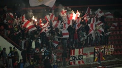 Football. Soccer. Fans cheering, singing, jumping and waving with torches. Arkistovideo