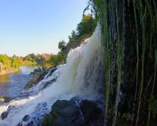 Turbulent waterfall splashing against rocks, river, wild nature, click for HD Stock Footage
