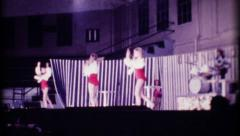 1235 - young girls in gymnastic stage show - vintage film home movie Stock Footage