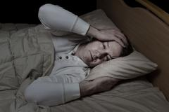 man very sick in bed - stock photo