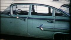 Stock Video Footage of 1240 - 1960 4 door Chevrolet in driveway - vintage film home movie