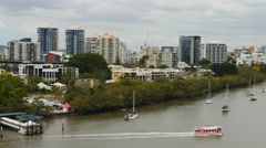 Ferries and boats Brisbane River TL pan PAL 4K Stock Footage
