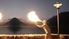 Fire artist presenting show with torchlight flame at night sky Stock Footage