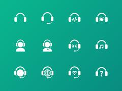 Earphones icons on green background. Stock Illustration