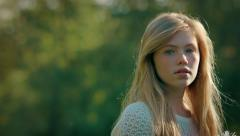 Girl Looks Off Into The Distance, Then At Camera, With A Serious Look Stock Footage