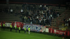 Football. Soccer. Fans cheering, singing and jumping on stands. Hooligans. Arkistovideo
